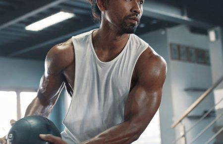 Man On Kettlebell Workout. Sexy Asian Sportsman With Strong, Hea